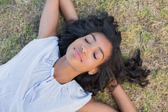Casual pretty woman napping on the grass Royalty Free Stock Photo