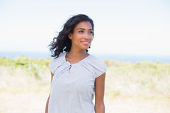 Casual pretty woman standing in the wind Royalty Free Stock Image
