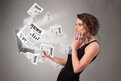 Casual young woman holdin notebook and reading the explosive new Royalty Free Stock Photo