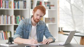 Casual Redhead Man Writing Letter