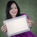 Casual schoolgirl with empty tablet screen Royalty Free Stock Photo