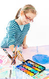 Casual schoolgirl painting Royalty Free Stock Photos