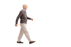 Casual senior man walking and smiling Royalty Free Stock Photography
