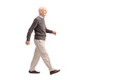 Casual senior man walking and smiling Royalty Free Stock Photography