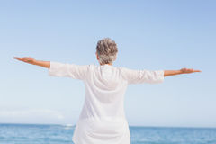 Casual senior woman with arms outstretched Stock Photography
