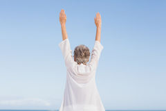 Casual senior woman with arms outstretched Royalty Free Stock Image