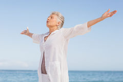 Casual senior woman with arms outstretched Royalty Free Stock Images
