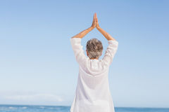 Casual senior woman with arms outstretched Stock Image