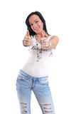 Casual sexy young woman in jeans thumbs up Royalty Free Stock Images