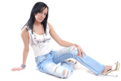 Casual sexy young woman sitting Stock Images