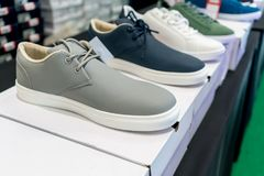 Casual shoes on white boxes for sale Stock Photography