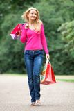 Casual shopping woman outdoors Stock Photo