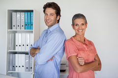 Casual smiling business team standing back to back. In the office Stock Photography
