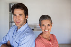 Casual smiling business team standing back to back. In the office Royalty Free Stock Photography