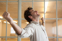 Casual smiling businessman with arms outstretched Stock Photo