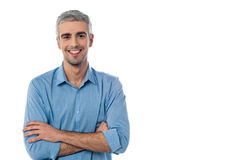 Casual smiling man with arms crossed Stock Photos