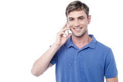 Casual smiling man calling on the phone Stock Images