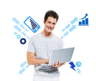 Casual Smiling Man Working on a Computer Royalty Free Stock Photo