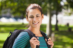 Casual smiling student looking at camera. On campus at college Royalty Free Stock Photography