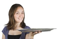 Casual smiling woman holding a tray Royalty Free Stock Photos