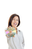 Casual smiling woman holding up compact disc or cd  and looking Royalty Free Stock Image