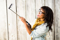 Casual smiling woman taking a selfie Royalty Free Stock Photography