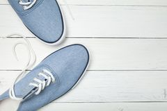 Casual sneakers on a white background, top view. Copy space for text stock images