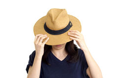 Casual South East Asian girl wearing hat hiding face Stock Photo
