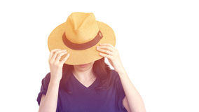 Casual South East Asian girl wearing hat hiding face Stock Image