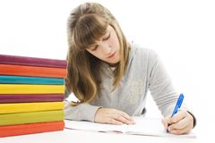 Casual student doing her homework. Stock Photo