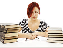 Casual student doing her homework Royalty Free Stock Image