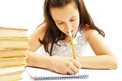 Casual student doing her homework Royalty Free Stock Photography