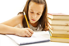 Casual student doing her homework Royalty Free Stock Photos