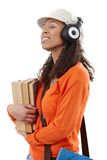 Casual student with earphones and books Royalty Free Stock Photography