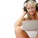 Casual student listening to music on the computer Stock Image