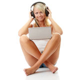Casual student listening to music on the computer Royalty Free Stock Photo