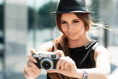 Casual student photographs with digital camera. Royalty Free Stock Image