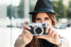 Casual student photographs with digital camera. Royalty Free Stock Photography