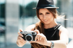 Casual student photographs with digital camera. Stock Image