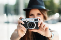 Casual student photographs with digital camera. Stock Images