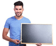 Casual student presenting a blank blackboard Stock Image
