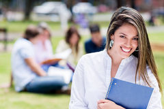 Casual student smiling outdoors Royalty Free Stock Photography