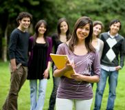 Casual students in the park Royalty Free Stock Photos