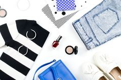 Casual style woman clothes and fashion accessories flat lay. Trendy patterns and prints concept. Top view. Casual style woman clothes and fashion accessories stock photo