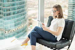 Casual style woman entrepreneur working in office Stock Photography