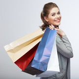 Casual style woman hold shopping bag. Studio female isolated po Stock Images