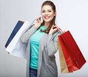 Casual style woman hold shopping bag. Studio femal Royalty Free Stock Images