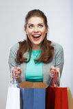 Casual style woman hold shopping bag. Studio female isolated po Royalty Free Stock Images