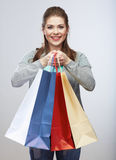 Casual style woman hold shopping bag. Studio female isolated po Stock Image