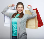 Casual style woman hold shopping bag. Studio female isolated po Royalty Free Stock Photo